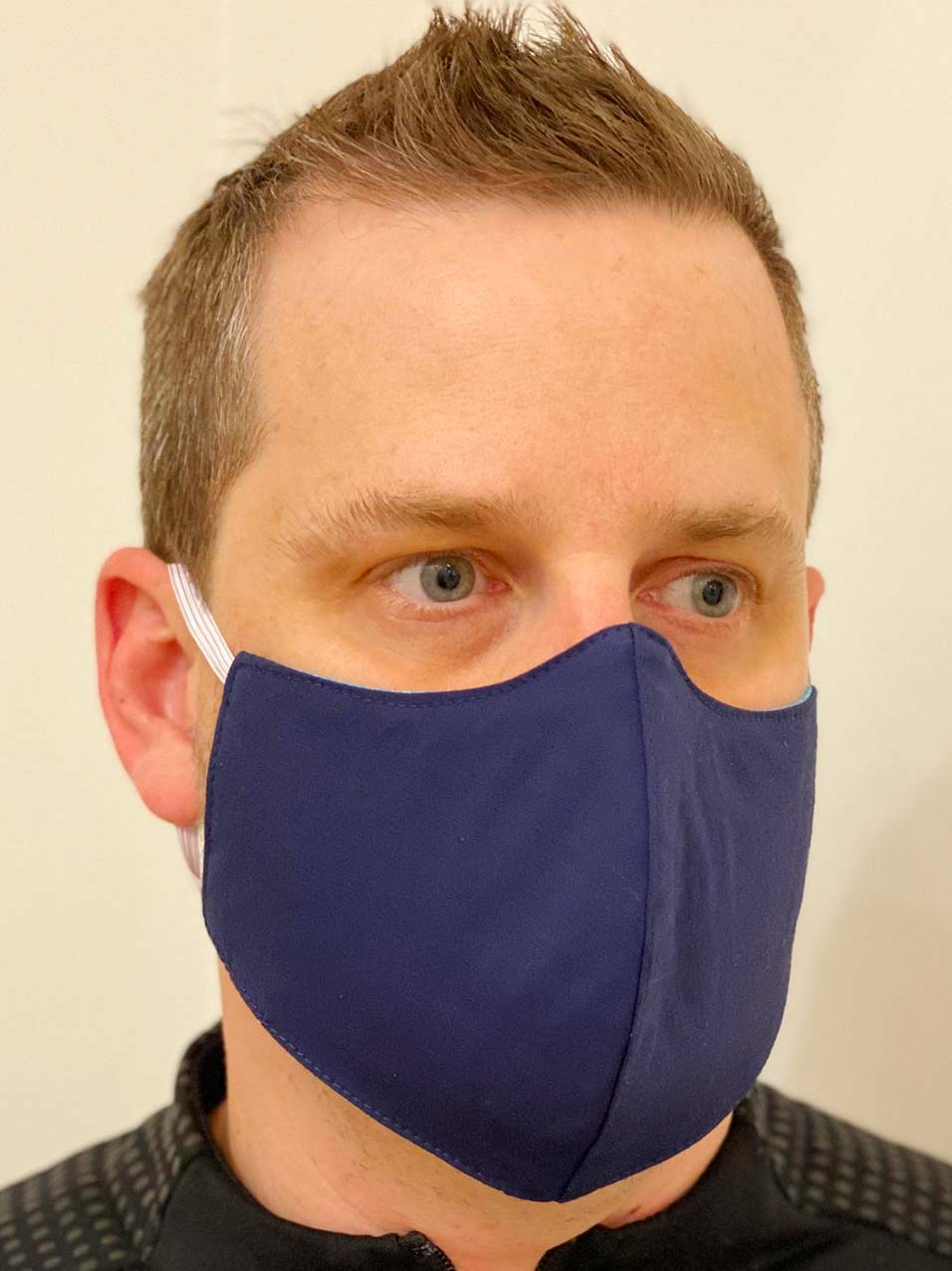 Blue face mask for COVID-19 being worn by a man